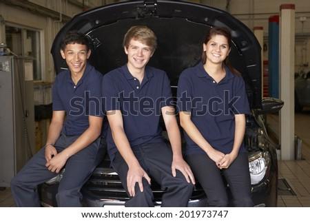 Young mechanics at work - stock photo