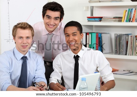 Young men at a computer - stock photo