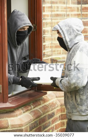 Young Men Breaking Into House - stock photo