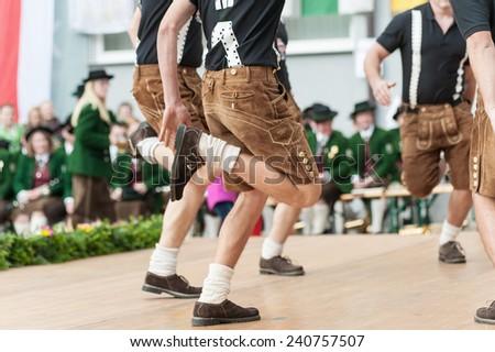 Young men doing an austrian traditional folk dance - stock photo