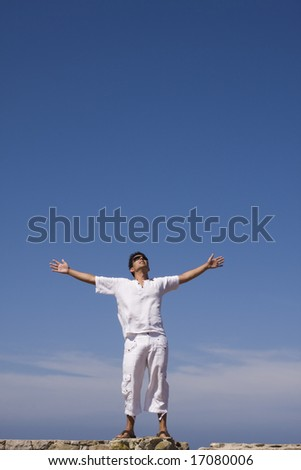 young men dress in white with the blue sky as background - stock photo