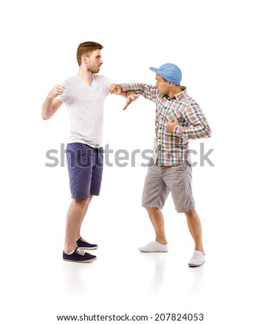 Young men fighting, isolated on white background - stock photo