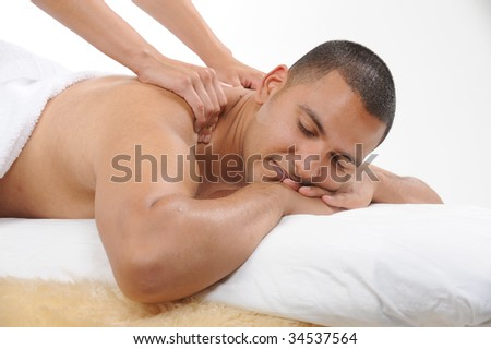 young men getting back massage - stock photo