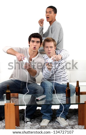 Young men playing computer games - stock photo