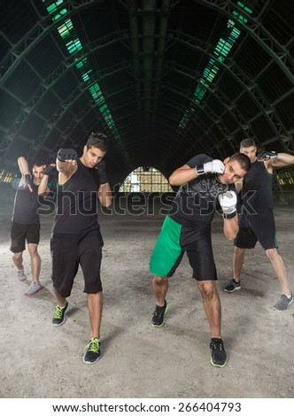 Young men practicing different hit with hand - stock photo