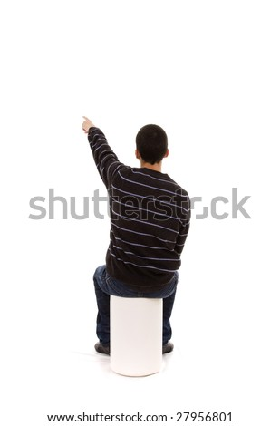 young men sit in a bench pointing away to the copy space - stock photo