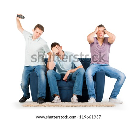 Young men sitting on a sofa disappointed, on white background - stock photo