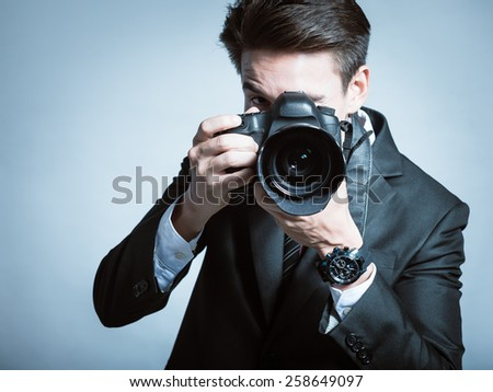 Young men using a professional camera - stock photo
