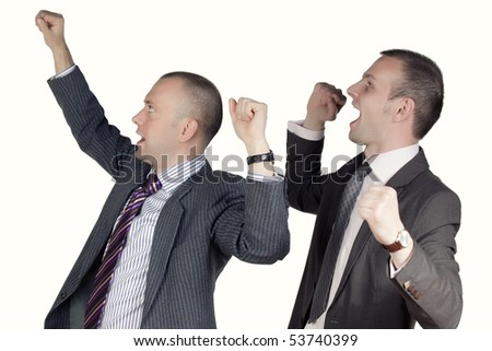 Young men with arms up - stock photo