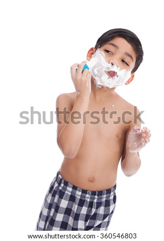 Young, mixed race boy pretending to shave.  Isolated on white. - stock photo