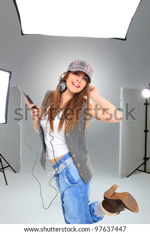 Young model in photographer's studio getting her photos shots done - stock photo