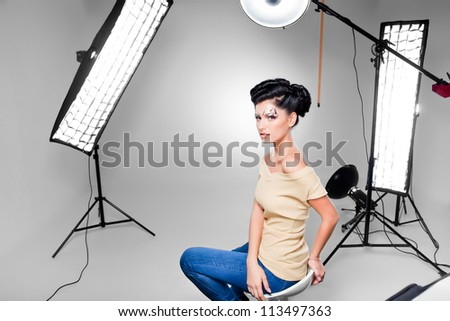 young model posing in professionally equipped studio - stock photo