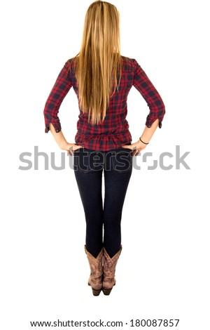 young model standing wearing western clothing rear view - stock photo