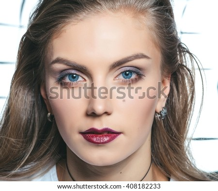 Young model with makeup. Glamour closeup fashion portrait. - stock photo