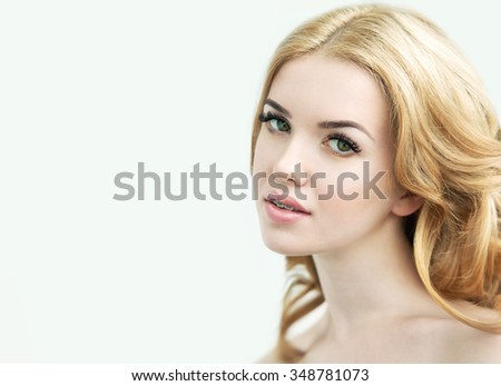Young Model with Perfect Fresh Skin, Long Eyelashes and Teeth Braces. Youth, Skin Care, Make up and Hair Concept. Healthy Smile. Orthodontic Treatment. Dental care. Aesthetic dentistry. - stock photo
