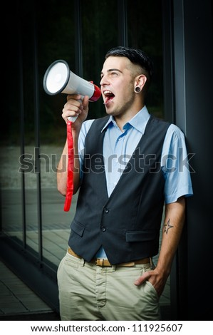 young modern business man with a megaphone - stock photo