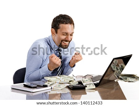 young modern businessman excited with his success while working with his laptop and accounting income  - stock photo