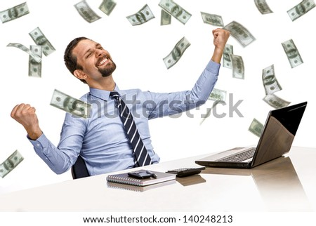 young modern businessman excited with his success while working with his laptop computer with money rain   - stock photo