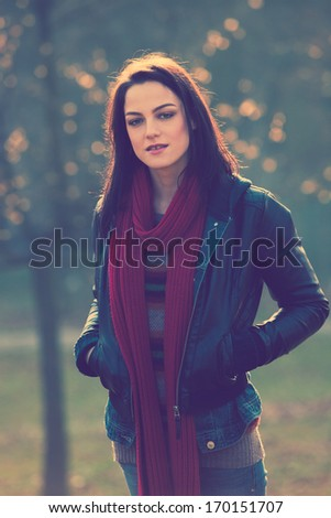 young modern girl in casual clothes outdoor portrait retro colors - stock photo