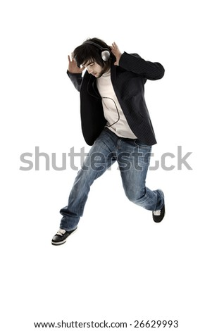 Young modern man jumping over a white background - stock photo