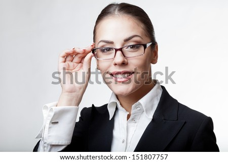 young modern professional businesswoman wearing glasses - stock photo