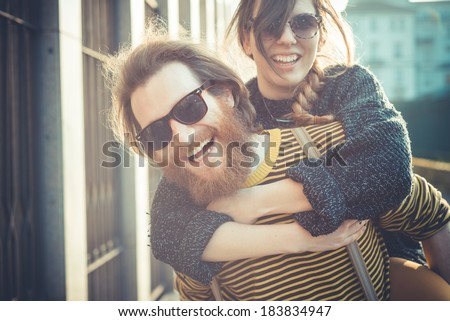 young modern stylish couple urban city outdoors - stock photo