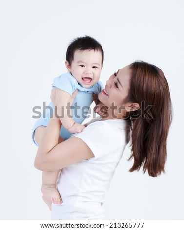 Young mom and son smile happily isolated  - stock photo