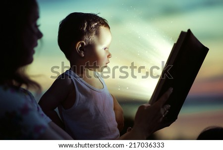 Young mom reading a book - stock photo