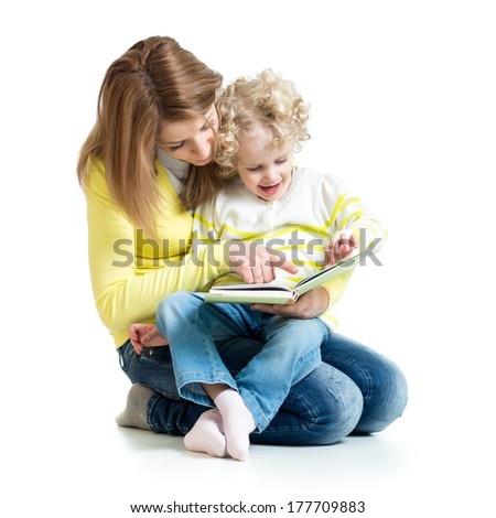 young mom reading a book to her daughter - stock photo