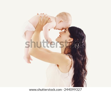 Young mom with her cute baby having fun together  - stock photo