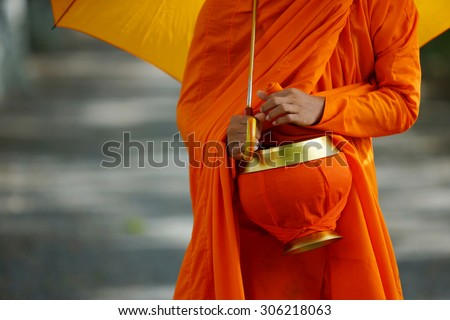 young monks are walking morning alms in An Giang, Vietnam . - stock photo
