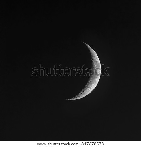 Young Moon - Waxing Crescent - stock photo