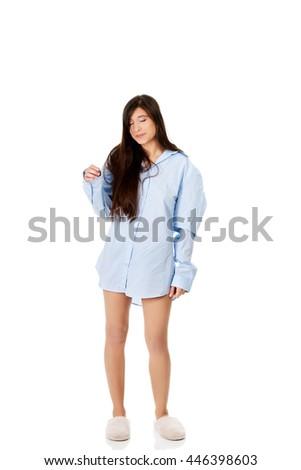 Young morning woman in big shirt. - stock photo