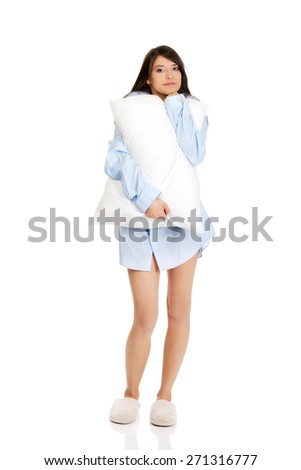 Young morning woman in big shirt and pillow. - stock photo