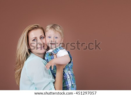 Young mother and baby boy - stock photo