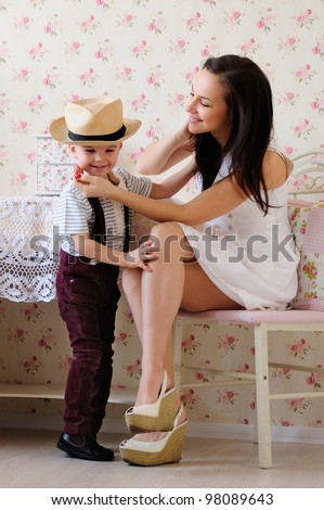 young mother and little son, a friendly talk. bright room, the interior - stock photo