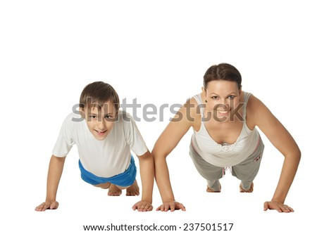 Young mother and son doing exercises, isolated on white background - stock photo