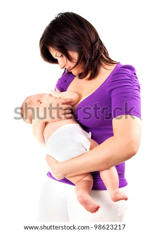 Young mother feeding her baby with breast - stock photo