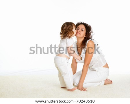 young mother having fun with her little son on the floor - stock photo