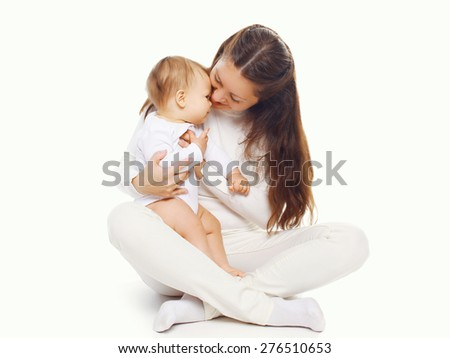 Young mother holding her baby on a white background - stock photo