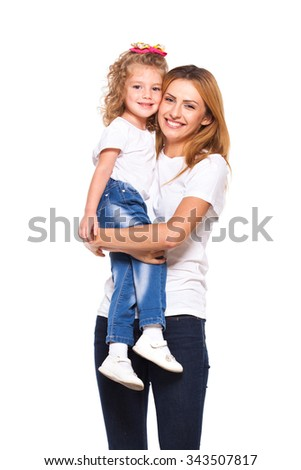 young mother hugging her little daughter isolated on white - stock photo