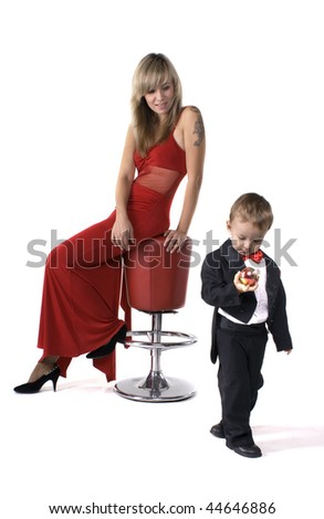 Young mother in a red dress and the little boy in a suit - stock photo