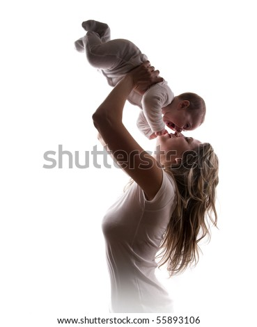Young mother lifts her baby up - stock photo