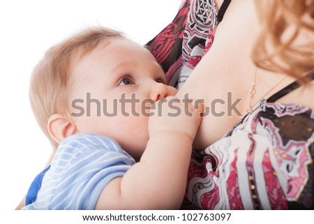 Young mother nurses the baby on a white background - stock photo