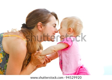 Young mother playing with baby - stock photo