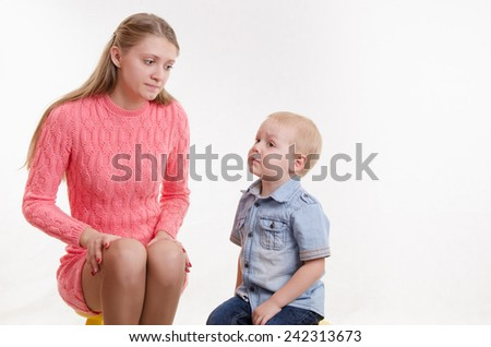 Young mother reproachfully looks at his young son - stock photo