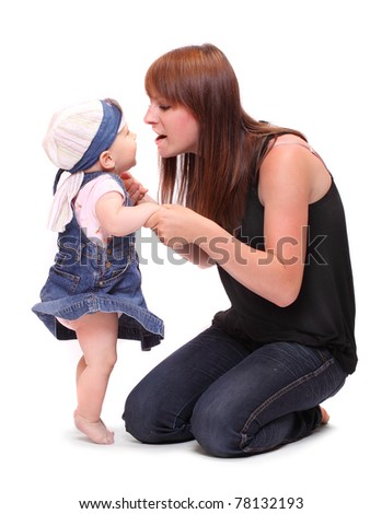 Young mother talking with her baby. Studio shot on a white background. - stock photo
