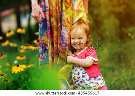 Young mother with her little baby outdoor. - stock photo