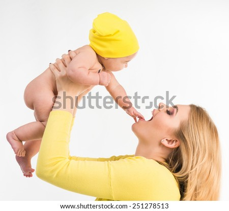 young mother with her little  daughter. Isolated on white background - stock photo