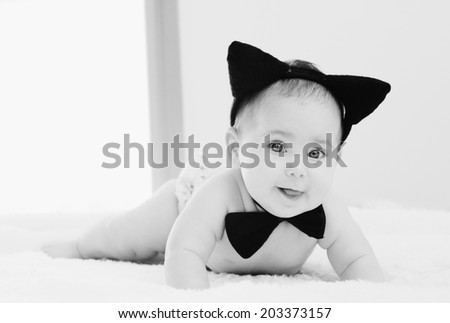 young mother with her 6 month old  baby - stock photo